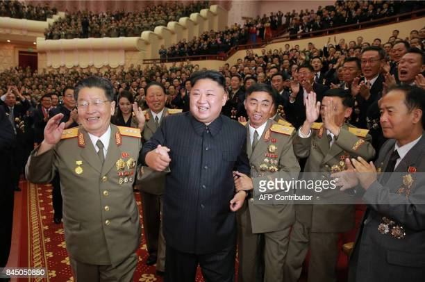 This undated picture released by North Korea's official Korean Central News Agency on September 10 2017 shows North Korean leader Kim JongUn...