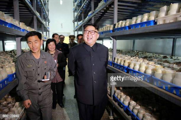 This undated picture released by the North Korean news agency KCNA on April 8 2017 shows North Korean leader Kim JongUn visiting the Pyongyang...