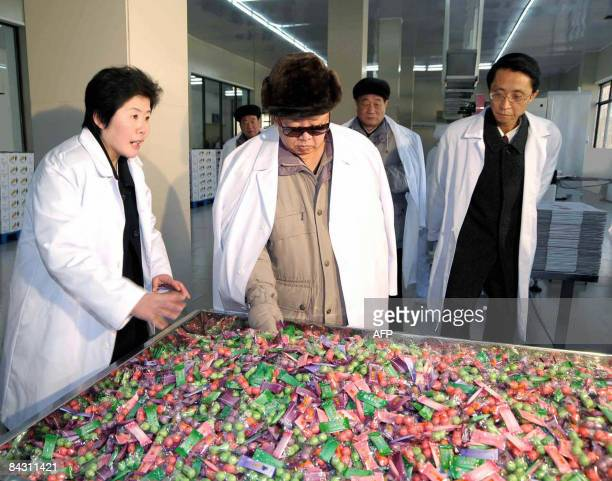 This undated picture released from Korean Central News Agency on January 16 2008 shows North Korean leader Kim Jong Il inspecting the newly built...
