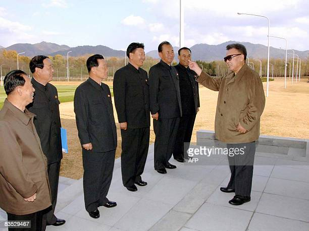 This undated picture released from Korean Central News Agency on November 2 shows North Korean leader leader Kim Jong Il visiting a football stadium...