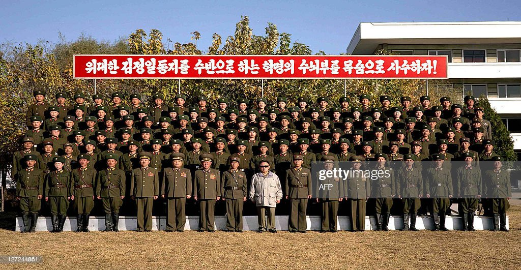 This undated picture released from Korean Central News Agency on November 5 2008 shows North Korean leader Kim Jong Il posing with soldiers as he...