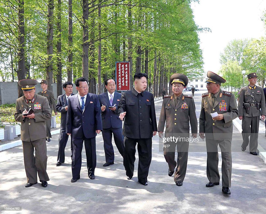 This undated picture, released from North Korea's official Korean Central News Agency (KCNA) on May 17, 2013 shows North Korean leader Kim Jong Un (C) inspecting the February 20 factory of the Korean People's Army (KPA), producing varieties of foodstuff at undisclosed place in North Korea. AFP PHOTO / KCNA via KNS CREDIT 'AFP PHOTO / KCNA VIA KNS' - NO