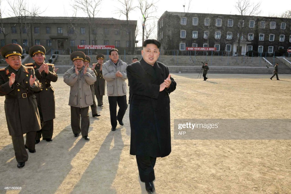 This undated picture released from North Korea's official Korean Central News Agency (KCNA) on January 12, 2014 shows North Korean leader Kim Jong-Un (C, front) inspecting the command of Korean People's Army (KPA) Unit 534. AFP PHOTO / KCNA via KNS REPUBLIC OF KOREA OUT THIS PICTURE WAS MADE AVAILABLE BY A THIRD PARTY. AFP CAN NOT INDEPENDENTLY VERIFY THE AUTHENTICITY, LOCATION, DATE AND CONTENT OF THIS IMAGE. THIS PHOTO IS DISTRIBUTED EXACTLY AS RECEIVED BY AFP ---EDITORS NOTE--- RESTRICTED TO EDITORIAL USE - MANDATORY CREDIT 'AFP PHOTO / KCNA VIA KNS' - NO