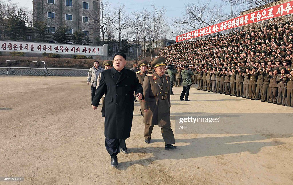 This undated picture released from North Korea's official Korean Central News Agency (KCNA) on January 12, 2014 shows North Korean leader Kim Jong-Un (front L) inspecting the command of Korean People's Army (KPA) Unit 534. AFP PHOTO / KCNA via KNS REPUBLIC OF KOREA OUT THIS PICTURE WAS MADE AVAILABLE BY A THIRD PARTY. AFP CAN NOT INDEPENDENTLY VERIFY THE AUTHENTICITY, LOCATION, DATE AND CONTENT OF THIS IMAGE. THIS PHOTO IS DISTRIBUTED EXACTLY AS RECEIVED BY AFP ---EDITORS NOTE--- RESTRICTED TO EDITORIAL USE - MANDATORY CREDIT 'AFP PHOTO / KCNA VIA KNS' - NO