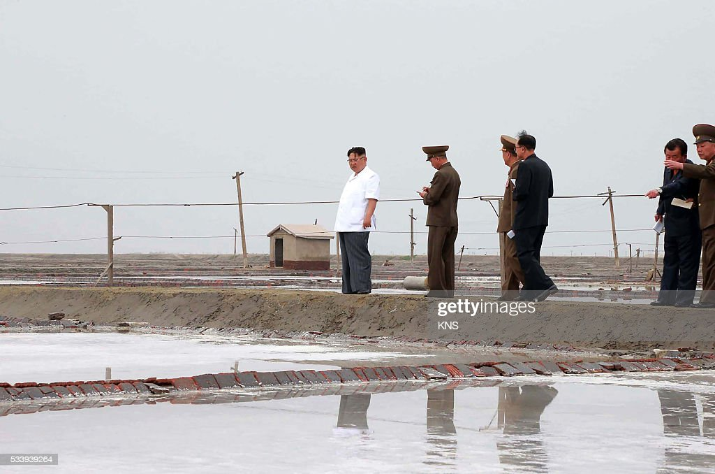 This undated picture released from North Korea's official Korean Central News Agency (KCNA) on May 24, 2016 shows North Korean leader Kim Jong-Un (L) visiting the Kwisong Saltern in Nampo city. REPUBLIC OF KOREA OUT CREDIT 'AFP PHOTO / KCNA VIA KNS' - NO