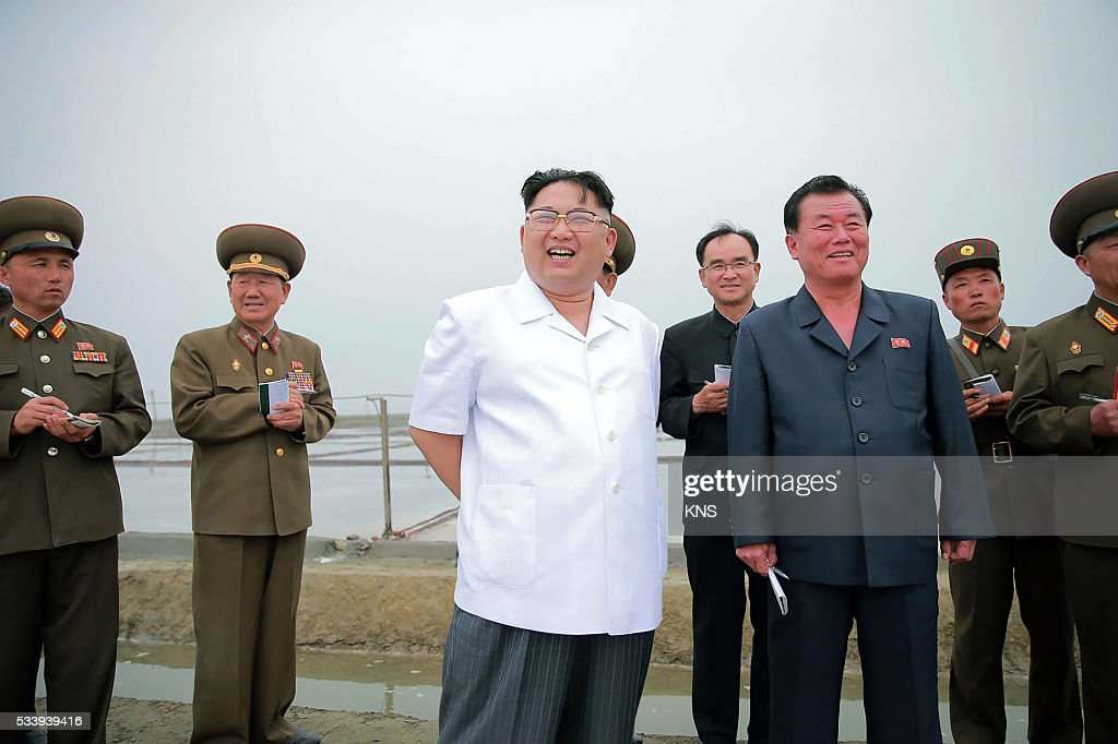 This undated picture released from North Korea's official Korean Central News Agency (KCNA) on May 24, 2016 shows North Korean leader Kim Jong-Un (3L) visiting the Kwisong Saltern in Nampo city. REPUBLIC OF KOREA OUT CREDIT 'AFP PHOTO / KCNA VIA KNS' - NO