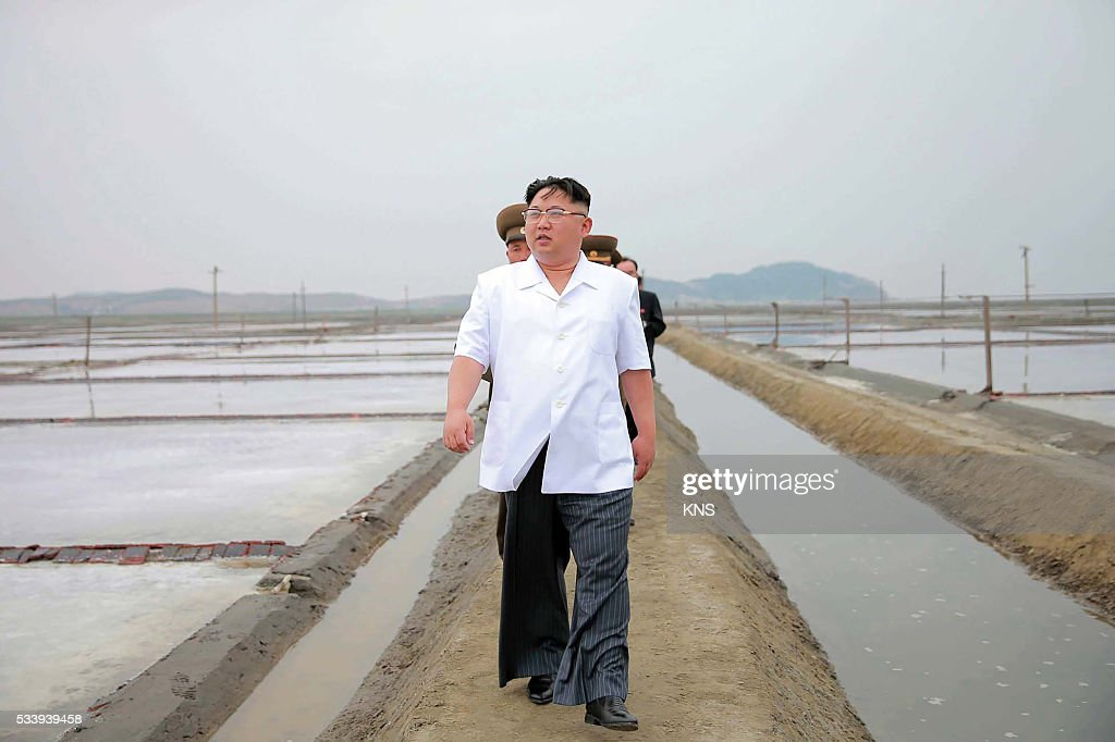 This undated picture released from North Korea's official Korean Central News Agency (KCNA) on May 24, 2016 shows North Korean leader Kim Jong-Un (C) visiting the Kwisong Saltern in Nampo city. REPUBLIC OF KOREA OUT CREDIT 'AFP PHOTO / KCNA VIA KNS' - NO