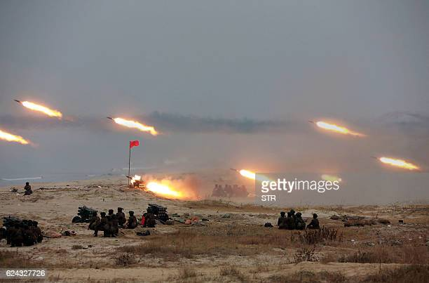 TOPSHOT This undated picture released from North Korea's official Korean Central News Agency on November 19 2016 shows a firing contest among women...