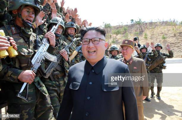 TOPSHOT This undated picture released from North Korea's official Korean Central News Agency on April 14 2017 shows North Korean leader Kim JongUn...