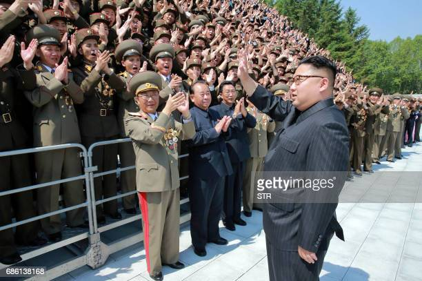 This undated picture released from North Korea's official Korean Central News Agency on May 20 2017 shows North Korean leader Kim JongUn waving to...
