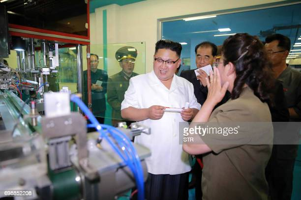 This undated picture released from North Korea's official Korean Central News Agency on June 20 2017 shows North Korean leader Kim JongUn visiting a...