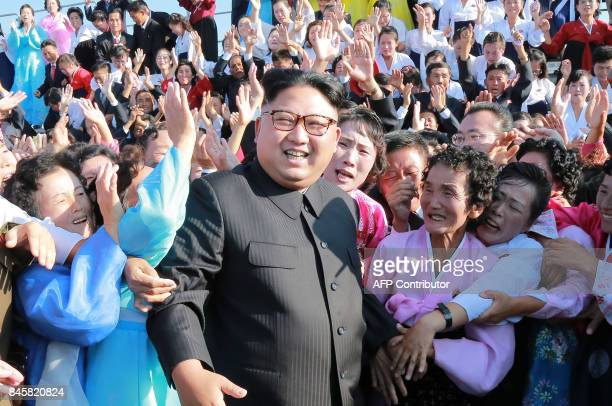 This undated picture released from North Korea's official Korean Central News Agency on September 12 2017 shows North Korean leader Kim JongUn...