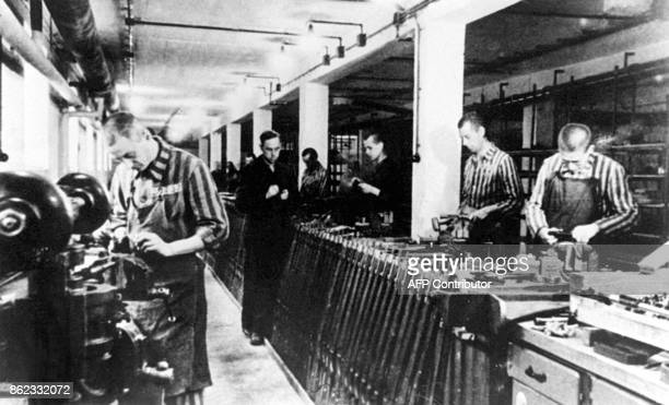 This undated picture shows forced labourers working in a weapons factory in Dachau during World War Two US judge Shirley Kram announced in New York...