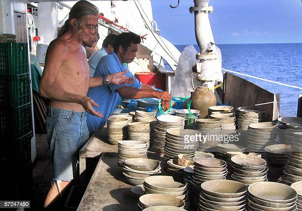 STORY 'INDONESIACRIMEARCHEOLOGYFRANCEGERMANY' This undated picture shows French diver JeanPaul Blancan inspecting their archeological find onboard a...
