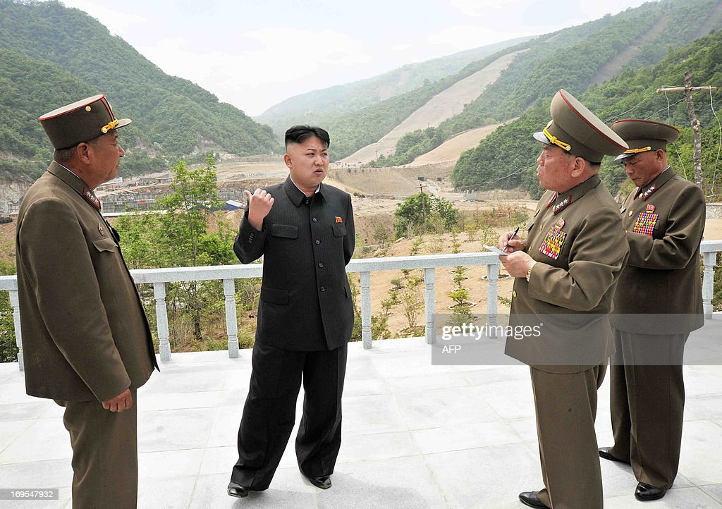 This undated recent photo released by North Korea's official Korean Central News Agency (KCNA) on May 27, 2013 shows North Korean leader Kim Jong-Un providing a field guidance to the Masik Pass Skiing Ground currently under construction by the Korean People's Army. THIS PICTURE WAS MADE AVAILABLE BY A THIRD PARTY. AFP CAN NOT INDEPENDENTLY VERIFY THE AUTHENTICITY, LOCATION, DATE, AND CONTENT OF THIS IMAGE. THIS PHOTO IS DISTRIBUTED EXACTLY AS RECEIVED BY AFP. AFP PHOTO / KCNA via KNS CREDIT ' AFP PHOTO / KCNA via KNS ' - NO
