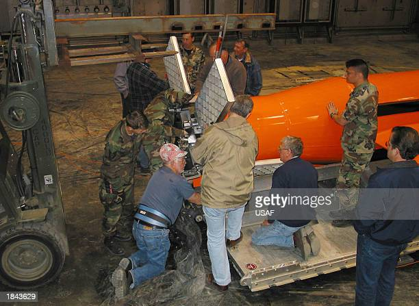 This US Department of Defense handout photo shows technicians preparing the Massive Ordinance Air Blast weapon March 11 2003 at Eglin Air Force Base...