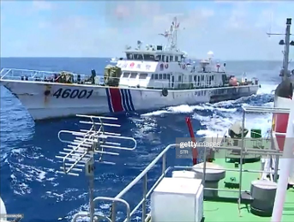 This video grab image taken on June 1 2014 from Vietnam Coast Guard ship 2016 and released on June 5 2014 shows the Chinese Coast Guard ship 46001...