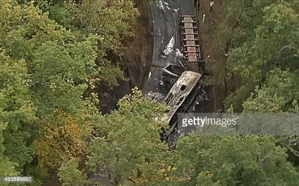 This video grab taken from footage obtained from French TV news channel BFM TV shows the wreckage of a coach carrying elderly daytrippers that...