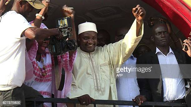 This video grab taken from footage shot by AFPTV shows The Gambia's Presidentelect Adama Barrow gesturing to the crowd following his victory in the...