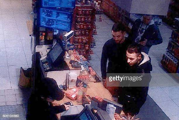 TOPSHOT This video image taken from a CCTV camera at a petrol station in Ressons North of Paris on November 11 2015 shows Salah Abdeslam a suspect in...