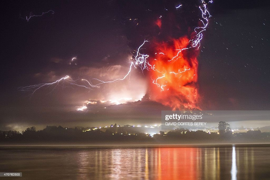 This view from Puerto Varas southern Chile shows a high column of ash and lava spewing from the Calbuco volcano on April 23 2015 Chile's Calbuco...