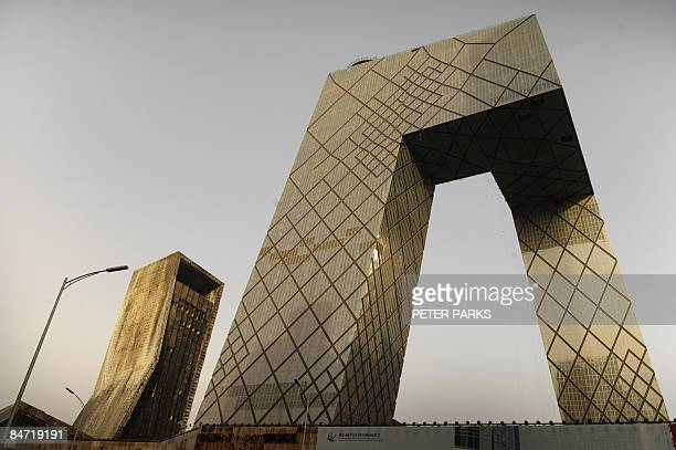 This view shows the outside the burntout Mandarin Oriental Hotel the day after a huge fire engulfed the building in Beijing on February 10 2009 A...