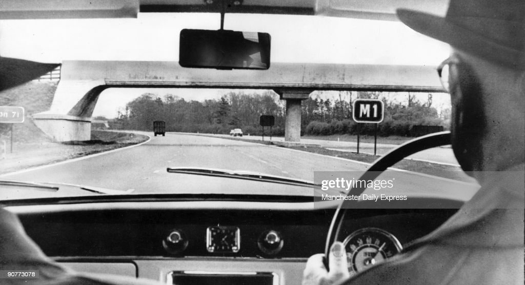 This view through a car windscreen shows the M1 motorway shortly after opening The motorway cost £23 million to build