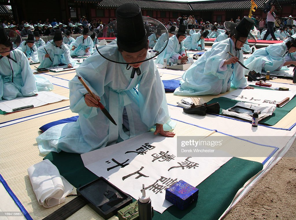 CONTENT] This was taken with a canon 300d digital camera and a 17-85mm lens. It is a re enactment of a civil service test and has been printed in ESL textbooks. Test taking has always been a huge part of Korean society and this depicts how civil servants had to display their ability in calligraphy in front of many examiners.