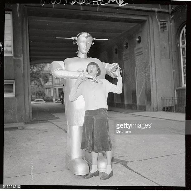 This young Hamburg lady seems to be yelling for help as a man from a flying saucer grabs her but actually she's complaining about Louie the robot's...