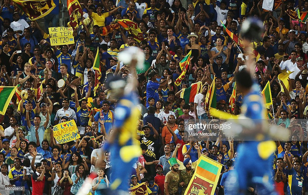 <a gi-track='captionPersonalityLinkClicked' href=/galleries/search?phrase=Thisara+Perera&family=editorial&specificpeople=4884953 ng-click='$event.stopPropagation()'>Thisara Perera</a> and <a gi-track='captionPersonalityLinkClicked' href=/galleries/search?phrase=Angelo+Mathews&family=editorial&specificpeople=5622021 ng-click='$event.stopPropagation()'>Angelo Mathews</a> of Sri Lanka acknowledge the fans after steering Sri Lanka to victory in game one of the Twenty20 international match between Australia and Sri Lanka at ANZ Stadium on January 26, 2013 in Sydney, Australia.