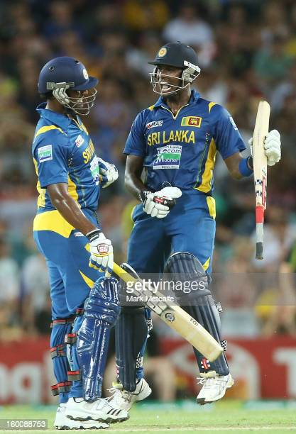 Thisara Perera and Angelo Mathews of Sri Lanka celebrate victory at the end of game one of the Twenty20 international match between Australia and Sri...