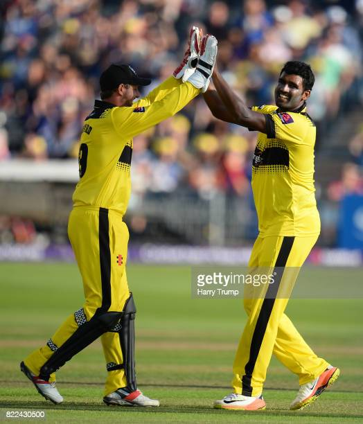 Thisara Perera and Phil Mustard of Gloucestershire celebrates the wicket of Colin Ingram of Glamorgan during the NatWest T20 Blast match between...