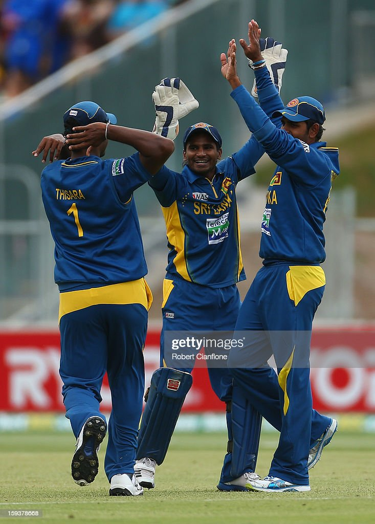 Thisara Perera, Kushal Janith Perera and Lahiru Thirimanne of Sri Lanka celebrate the wicket of George Bailey of Australia during game two of the Commonwealth Bank One Day International series between Australia and Sri Lanka at Adelaide Oval on January 13, 2013 in Adelaide, Australia.