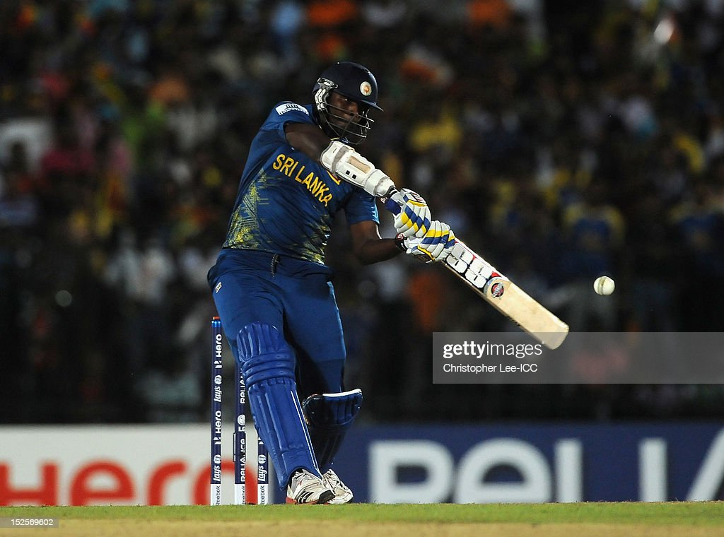 <a gi-track='captionPersonalityLinkClicked' href=/galleries/search?phrase=Thisara+Perera&family=editorial&specificpeople=4884953 ng-click='$event.stopPropagation()'>Thisara Perera</a> of Sri Lanka bats during the ICC World Twenty20 2012 Group C match between Sri Lanka and South Africa at Mahinda Rajapaksa International Cricket Stadium on September 22, 2012 in Hambantota, Sri Lanka.
