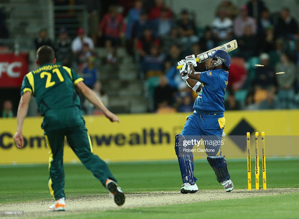 <a gi-track='captionPersonalityLinkClicked' href=/galleries/search?phrase=Thisara+Perera&family=editorial&specificpeople=4884953 ng-click='$event.stopPropagation()'>Thisara Perera</a> of Sri Lanka is bowled by <a gi-track='captionPersonalityLinkClicked' href=/galleries/search?phrase=Moises+Henriques&family=editorial&specificpeople=875812 ng-click='$event.stopPropagation()'>Moises Henriques</a> of Australia during game five of the Commonwealth Bank One Day International Series between Australia and Sri Lanka at Blundstone Arena on January 23, 2013 in Hobart, Australia.