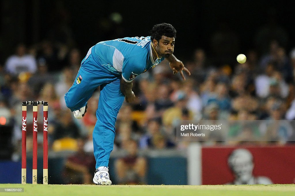 <a gi-track='captionPersonalityLinkClicked' href=/galleries/search?phrase=Thisara+Perera&family=editorial&specificpeople=4884953 ng-click='$event.stopPropagation()'>Thisara Perera</a> of the Heat bowls during the Big Bash League match between the Brisbane Heat and the Hobart Hurricanes at The Gabba on December 9, 2012 in Brisbane, Australia.