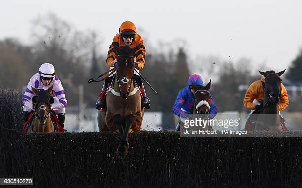 Thistlecrack ridden by Tom Scudamore clears an early fence before going on to win The 32Red King George VI Steeple Chase Race run during day one of...