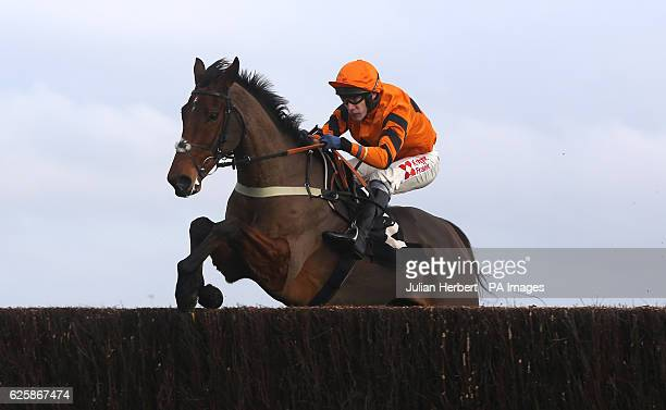Thistlecrack ridden by Tom Scudamore clears the last fence before going on to win The bet365 Novices' Steeple Chase Race run during Hennessy Gold Cup...