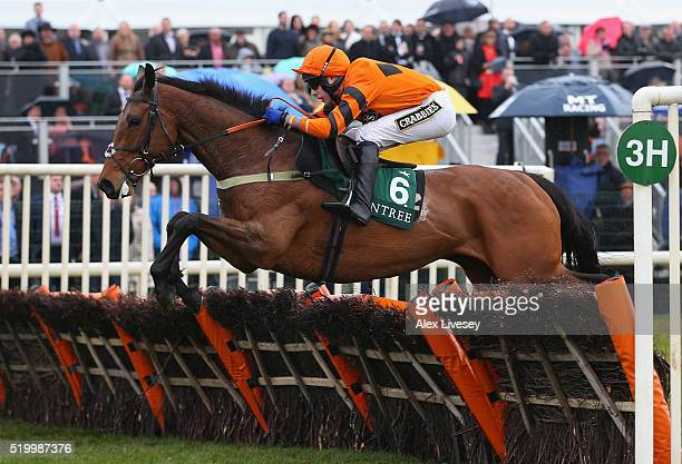 Thistlecrack ridden by Tom Scudamore jumps the last fence on their way to victory in the Liverpool Stayers' Hurdle race at Aintree Racecourse on...