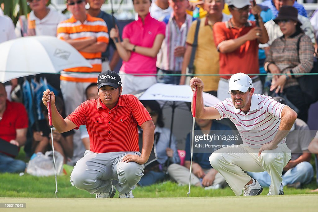 Thitiphun Chuayprakong (L) of Thailand and Charl Schwartzel of South Africa in action during round four of the Thailand Golf Championship at Amata Spring Country Club on December 9, 2012 in Bangkok, Thailand.