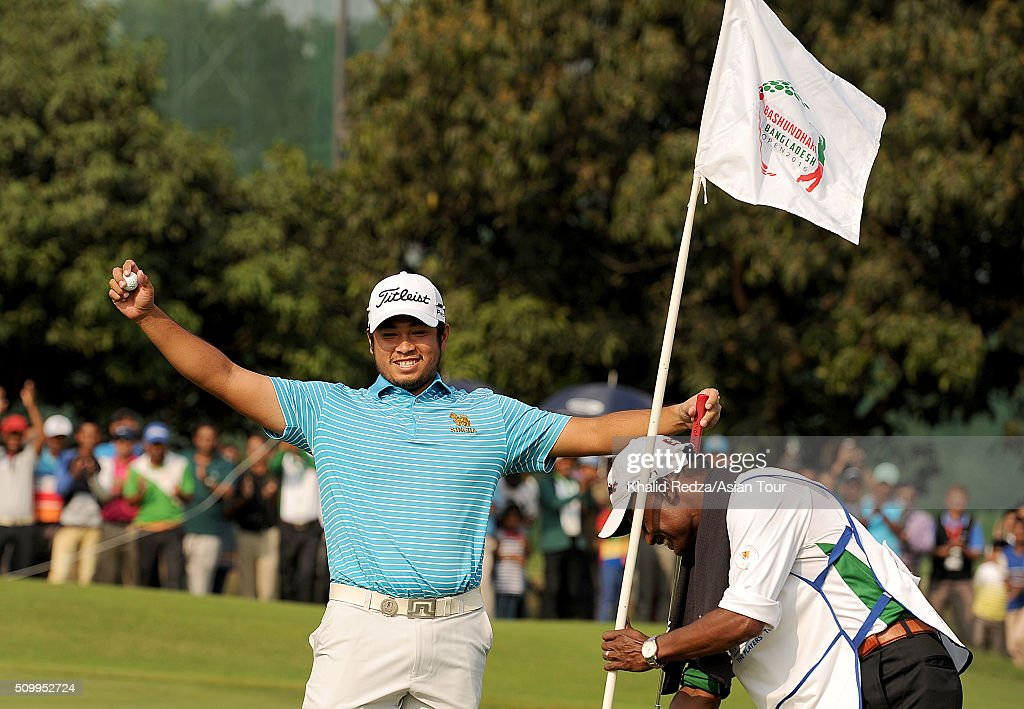 Thitiphun Chuayprakong of Thailand celebrating his putt during round four of the Bashundhara Bangladesh Open at Kurmitola Golf Club on February 13, 2016 in Dhaka, Bangladesh.