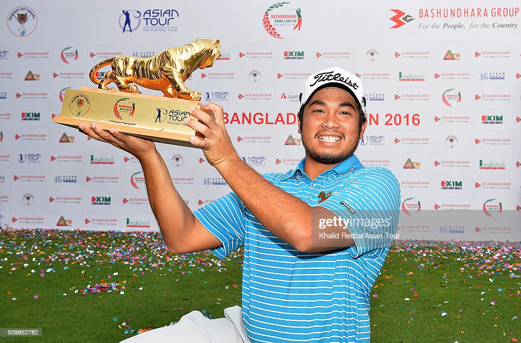 Thitiphun Chuayprakong of Thailand posing with the championship trophy after round four of the Bashundhara Bangladesh Open at Kurmitola Golf Club on February 13, 2016 in Dhaka, Bangladesh.