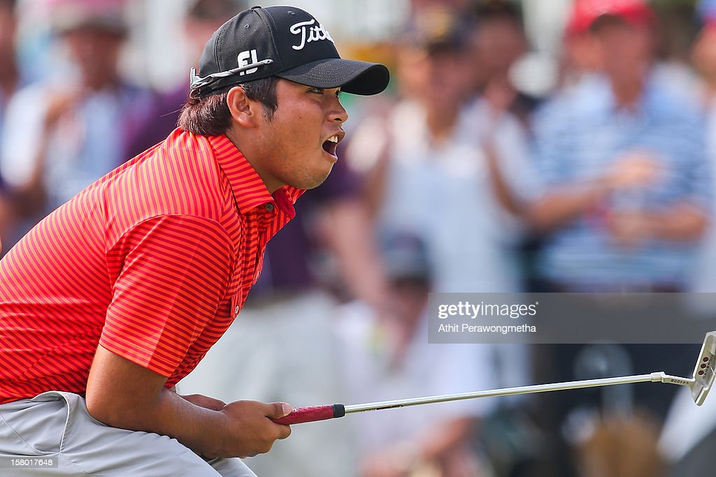 Thitiphun Chuayprakong of Thailand reacts after he plays a shot during round four of the Thailand Golf Championship at Amata Spring Country Club on December 9, 2012 in Bangkok, Thailand.