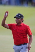 Thitiphun Chuayprakong of Thailand reacts after he plays a shot during round four of the Thailand Golf Championship at Amata Spring Country Club on...