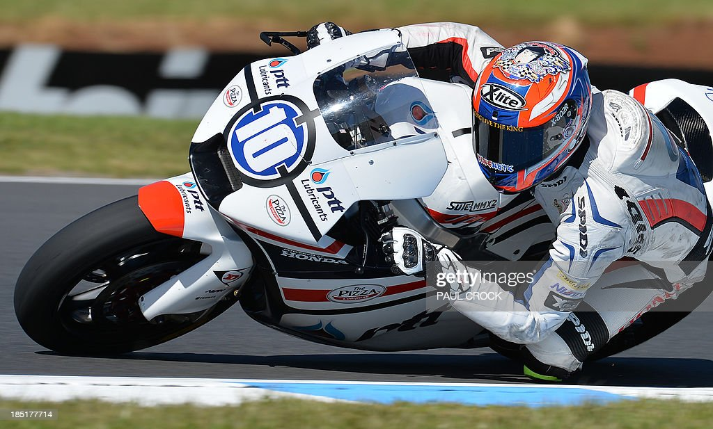 Thitipong Warokorn of Thailand races his Suter through a corner during practice for the Australian Moto2 Grand Prix at Phillip Island on October 18, 2013. AFP PHOTO/Paul Crock USE
