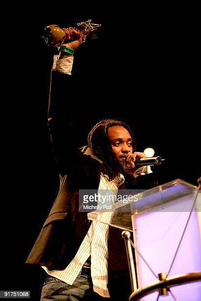 Thokozani Dube accepts the Legend Awards on behalf of his deceased father Lucky Dube at the MTV Africa Music Awards with Zain at the Moi...