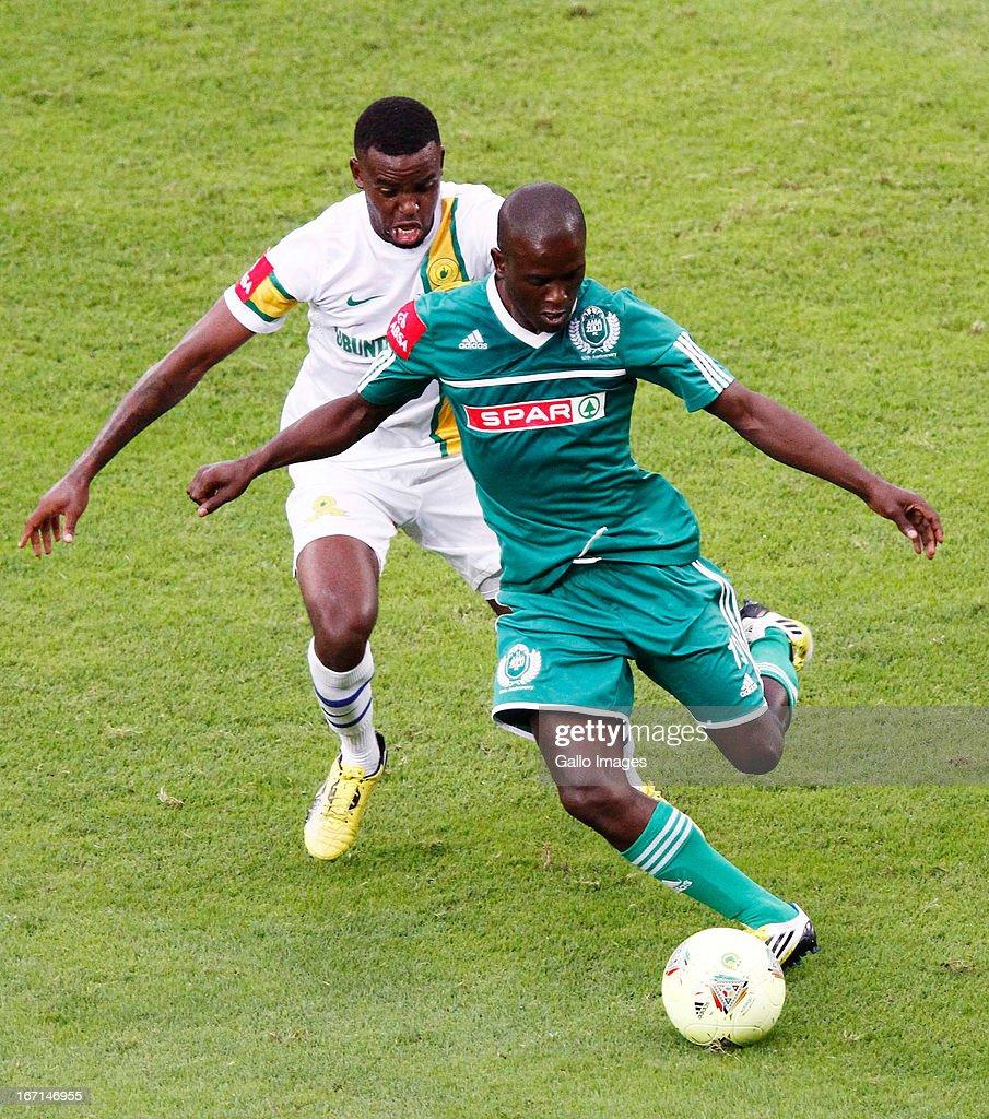 Thokozani Mshengu of AmaZulu (R) clears the ball during the Absa Premiership match between AmaZulu and Mamelodi Sundowns at Moses Mabhida Stadium on April 21, 2013 in Durban, South Africa.