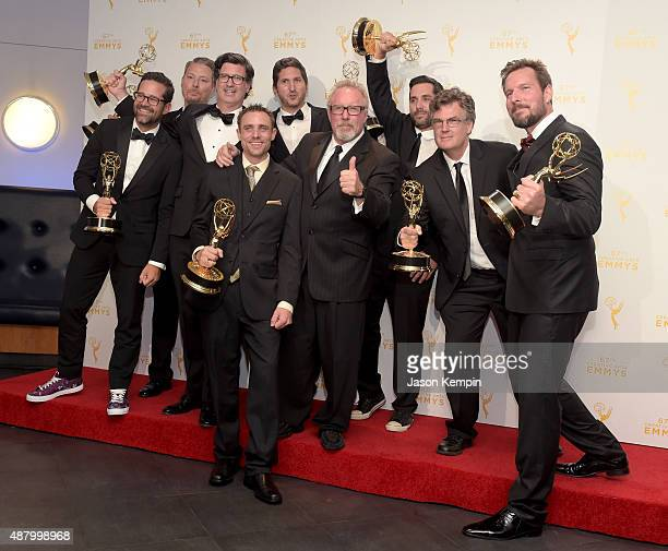 Thom Beers and the team of 'Deadliest Catch' winners of Outstanding Unstructured Reality Program pose in the press room during the 2015 Creative Arts...