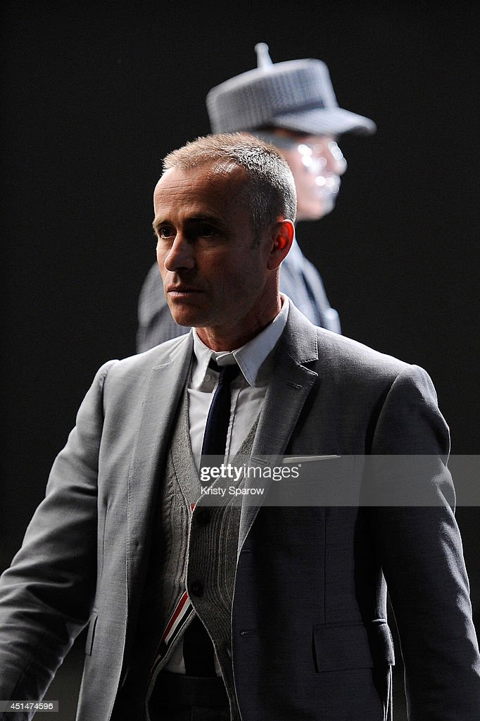 <a gi-track='captionPersonalityLinkClicked' href=/galleries/search?phrase=Thom+Browne+-+Fashion+Designer&family=editorial&specificpeople=591994 ng-click='$event.stopPropagation()'>Thom Browne</a> acknowledges the audience during the <a gi-track='captionPersonalityLinkClicked' href=/galleries/search?phrase=Thom+Browne+-+Fashion+Designer&family=editorial&specificpeople=591994 ng-click='$event.stopPropagation()'>Thom Browne</a> show as part of Paris Fashion Week Menswear Spring/Summer 2015 on June 29, 2014 in Paris, France.