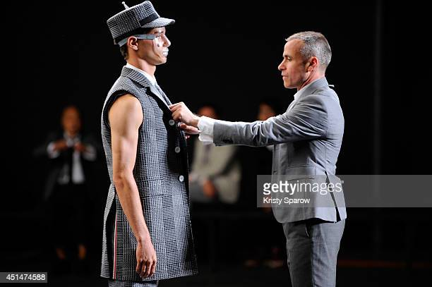 Thom Browne prepares a model during the Thom Browne show as part of Paris Fashion Week Menswear Spring/Summer 2015 on June 29 2014 in Paris France